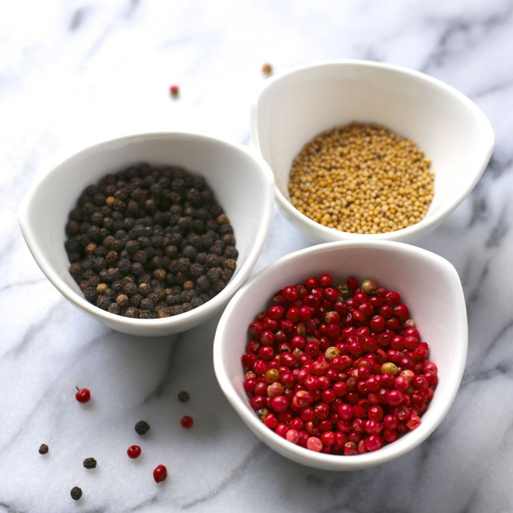 Black peppercorns, pink peppercorns, mustard seeds