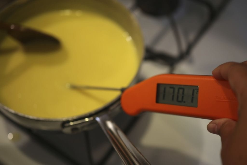 Testing temperature of lemon curd
