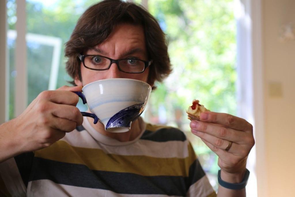 Matt enjoying scone and tea