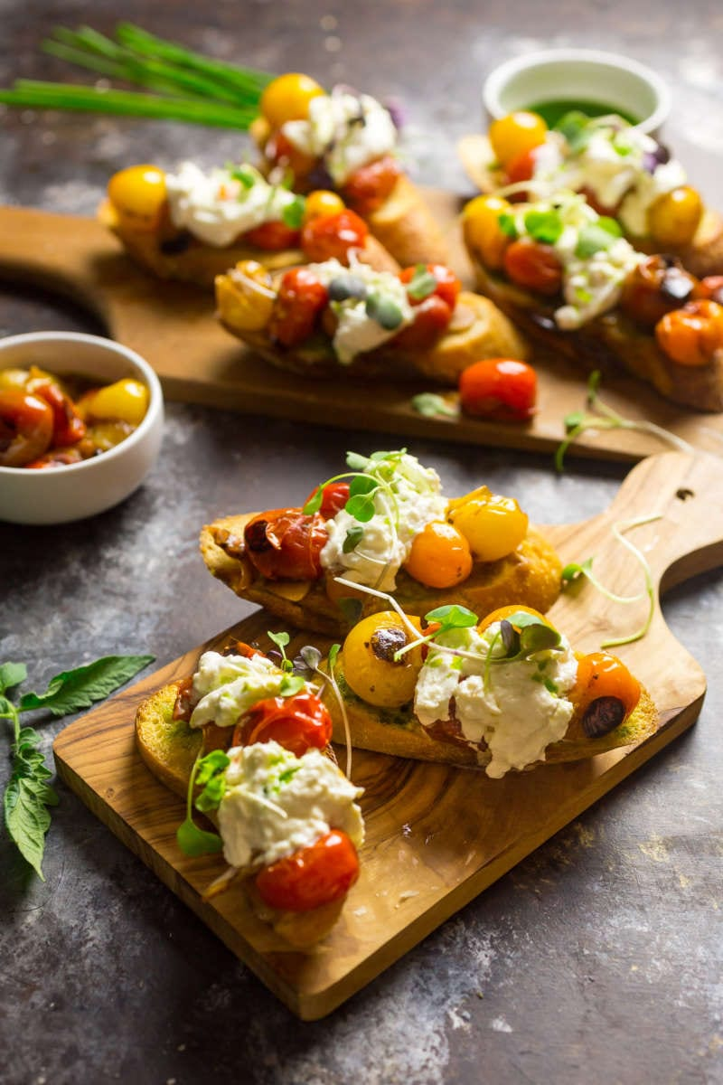 Crostini with Blistered Cherry Tomatoes, Burrata and Chive Oil