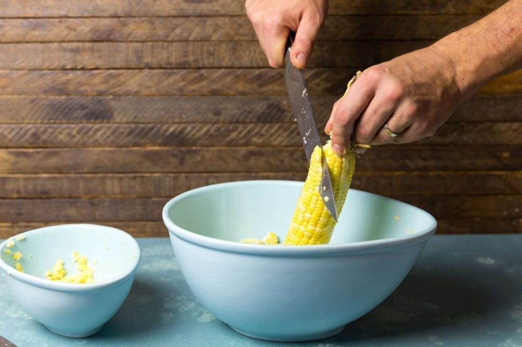 Cutting corn off the cob