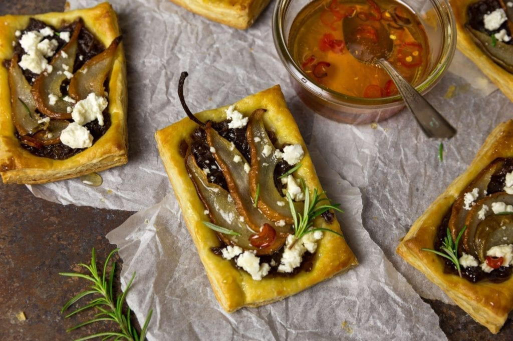Pear & Caramelized Red Onion Tarts with Goat Cheese and Spicy Honey Drizzle