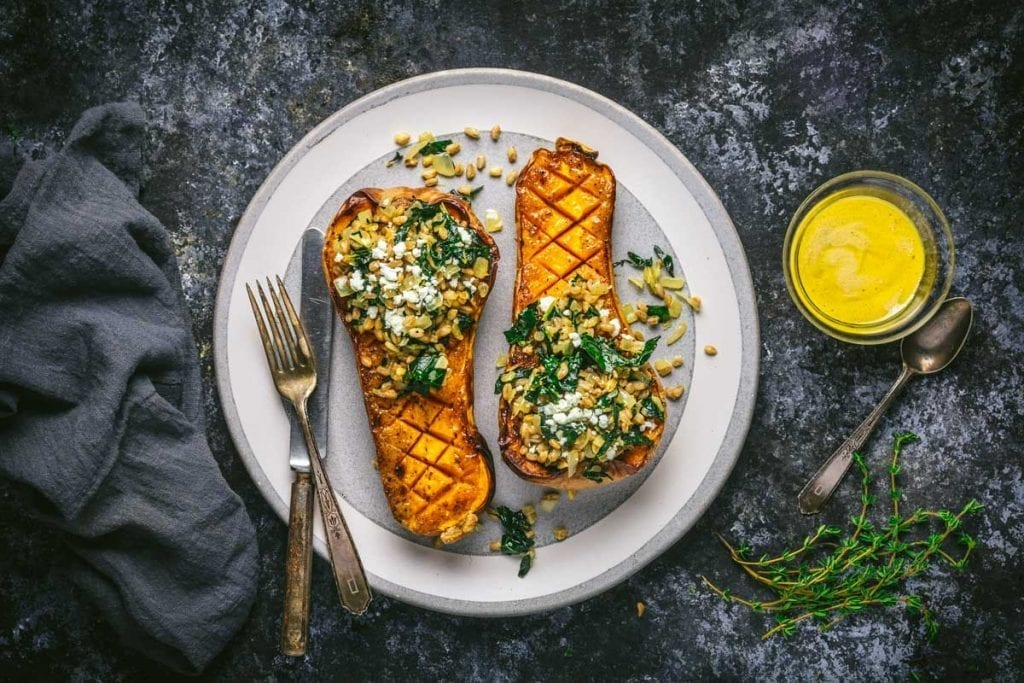 Mustard Glazed Butternut Squash Stuffed with Farro and Winter Greens